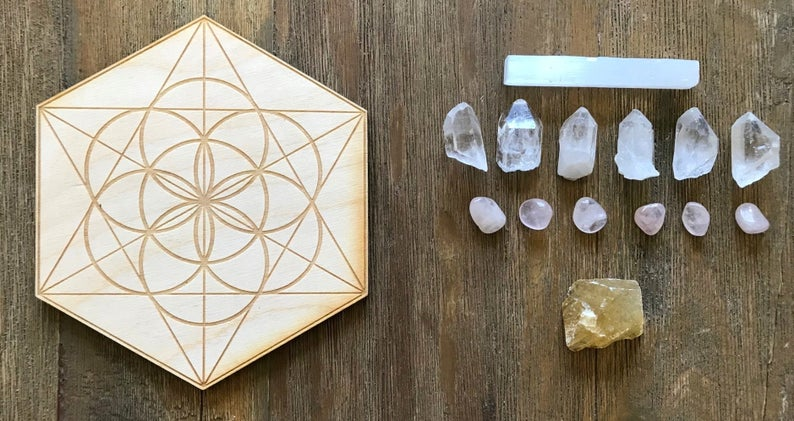 Wooden crystal grid and array of crystals are ready to be placed in a crystal altar